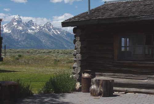 Enjoy breakfast behind small cabin, built in the 30s, vewing the Grand Tetons